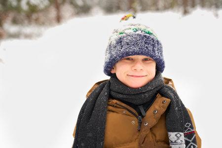 Portrait of little boy in winter