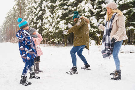 Family playing outdoors at winter 스톡 콘텐츠