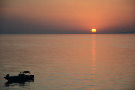 aegean: Sunset over the Aegean sea with boat Stock Photo