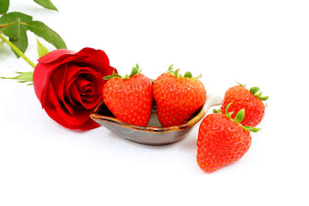 eacute: A Red Rose and Strawberries on a White Background Stock Photo