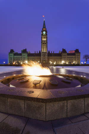 centennial: Parliament Hill and the Centennial Flame of Ottawa, Canada at dawn in winter