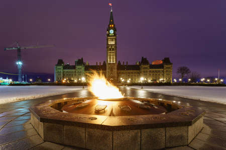 commons: Parliament Hill and the Centennial Flame of Ottawa, Canada at dawn in winter