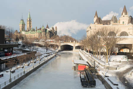 rideau canal: Ottawa Rideau Canal Skateway in winter with Parliament Hill and Chateau Laurier in the background