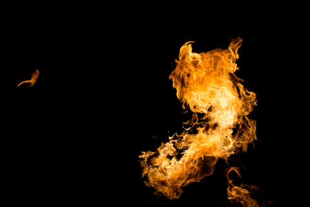 engulfed: Fire in black background
