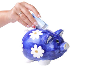 Blue piggy bank with 20 euros bill in slot isolated on white photo