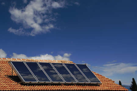 Solar cells for ecological energy on a roof of a family home photo