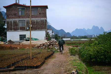 Bike tours and cycling to villages around Yangshuo, Guilin, Guangxi with beautiful karst landscape in China