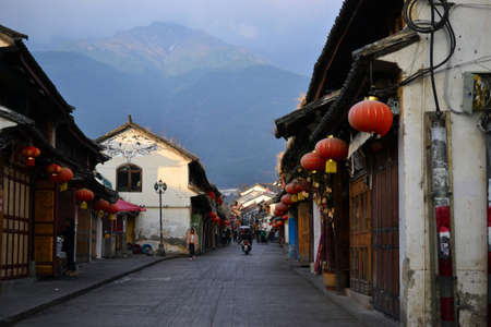 Old city of Dali, Yunnan, China - views of the street and parks, temples, traditional chinese architecture and life
