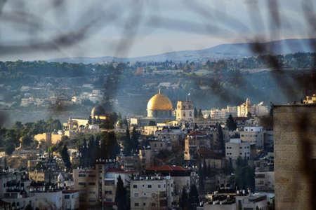 Dome of rocks between trees, Temple Mount of Jerusalem Фото со стока