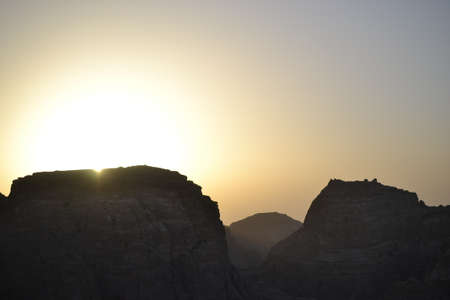 sunset in Petra, Jordan - ancient Nabatean city in red natural rock and with local bedouins, UNESCO world heritage