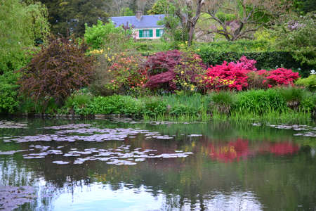France Giverny Claude Monet garden in spring, flowers and lakes sea rose