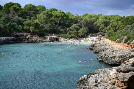 Rock formations for climbing at Cala Sa Nau beach and Cala dOr city, Palma Mallorca Island, Spain Banco de Imagens