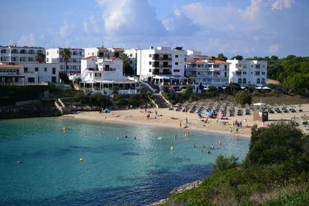 Turquoise water and rocks at Cala Marcal beach and Cala dOr city, Palma Mallorca Island, Spain