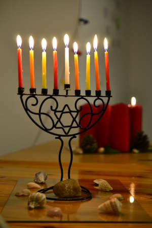 Chanukkiah, eight armed menorah for Chanukka Jewish feast, candle lighting and Christmas candles