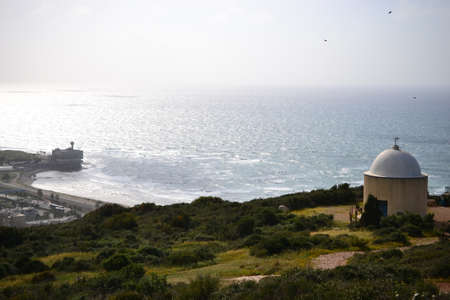 Hike to Stella Maris in Haifa in Spring, Israel - flowery path and holy family chapel on top of Mount Carmel