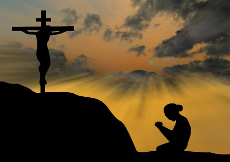 Woman praying under the cross Stock Photo