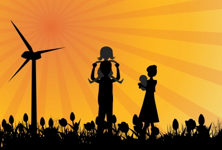 Silhouette of family in field with windmil