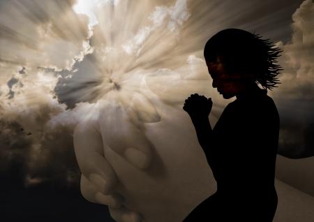 ひざまずく: 女性の祈りのシルエット