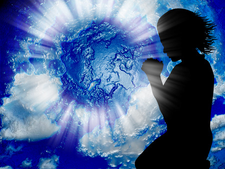 Woman praying for the world                              photo