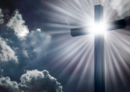 cross: Christian cross with bright sun and clouds background