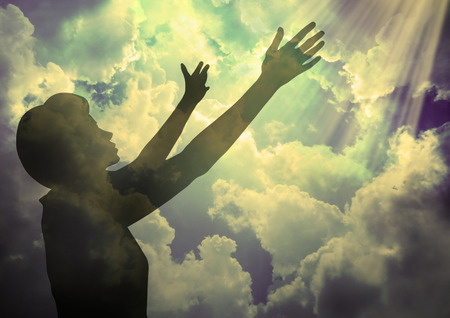 Praising God- Silhouette of a woman alone with God