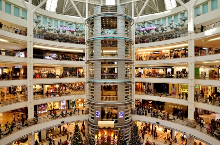 Kuala Lumpur, Malaysia - December 7,2013  Interior of KLCC with Christmas decoration and the people are walking and shopping around it  Editoriali