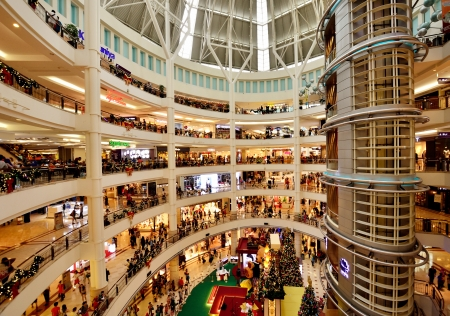 Kuala Lumpur, Malaysia - December 7,2013  Interior of KLCC with Christmas decoration and the people are walking and shopping around it  Editorial