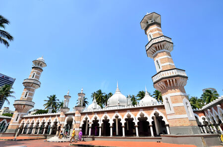 workship: Kuala Lumpur,Malaysia- February 16, 2014  Tourists can seen exploring around the Masjid Jamek mosque which is located at the heart of Kuala Lumpur city  Editorial