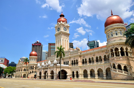 merdeka: Kuala Lumpur, Malaysia - February 16, 2014  The tourists can seen walking around the Sultan Abdul Samad building which is located in front of the Merdeka Square in Jalan Raja,Kuala Lumpur Malaysia