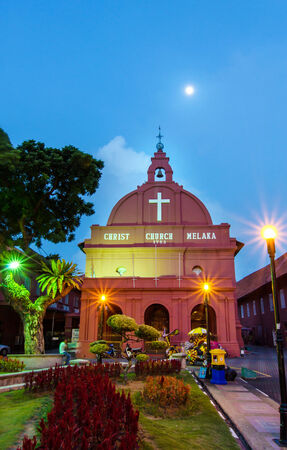 traditionally dutch: Malacca,Malaysia - October 26, 2012 Evening view of the Christ Church Malacca and Dutch Square,people can seen around the Dutch Square