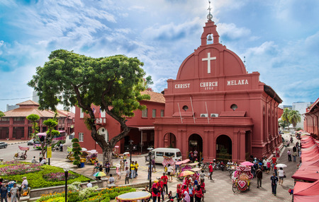 Malacca,Malaysia - June 15, 2014  Afternoon view of the Christ Church Malacca and Dutch Square,tourists and local people can seen around the Dutch Square  It s capital Malacca Town, listed as a UNESCO World Heritage Site
