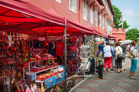traditionally dutch: Malacca,Malaysia - June 15, 2014  Souvenir stalls at Dutch Square and it usually crowded with locals as well as tourists It s capital Malacca Town, listed as a UNESCO World Heritage Site