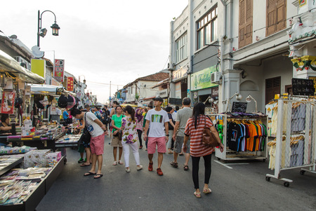 night market: Malacca,Malaysia - June 15, 2014 The night market on Friday,Saturday and Sunday is the best part of the Jonker Street, it sells everything from tasty foods to cheap keepsakes  People can seen exploring around the night market  Editorial