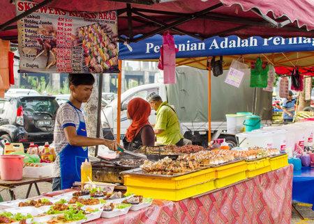 break fast: Kuala Lumpur,Malaysia - July 13, 2014  The hawkers preparing the foods in Ramadan Bazaar It is established for muslim to break fast during the holy month of Ramadan