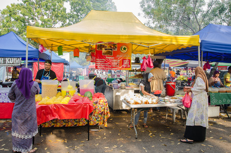 break fast: Kuala Lumpur,Malaysia - July 23, 2014  People can seen buying foods around the Ramadan Bazaar It is established for muslim to break fast during the holy month of Ramadan