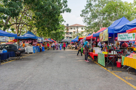 break fast: Kuala Lumpur,Malaysia - July 23, 2014  People can seen walking and buying foods around the Ramadan Bazaar It is established for muslim to break fast during the holy month of Ramadan
