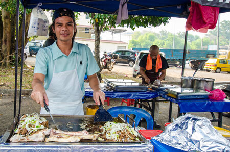 Kuala Lumpur,Malaysia - July 23, 2014  The hawkers preparing the grilled lamb in Ramadan Bazaar It is established for muslim to break fast during the holy month of Ramadan