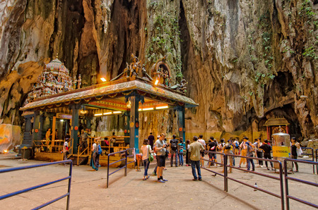 cave exploring: Kuala Lumpur,Malaysia - August 3, 2014  Tourist can seen exploring around the temple within the cave in Batu Caves Kuala Lumpur