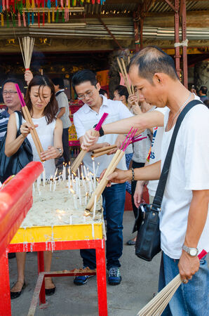 workship: Selangor,Malaysia - September 26, 2014 : Chinese ethnic Malaysian lights joss-sticks during Nine Emperor Gods Festival at a temple in Ampang. Editorial