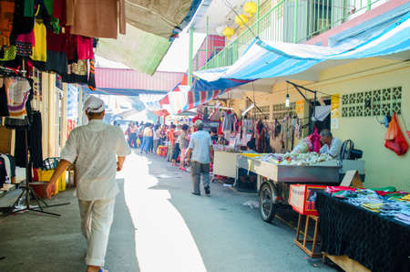 personal god: Selangor,Malaysia - September 26, 2014 : During the The Nine Emperor Gods Festival,there are some stalls around the temple selling yummy food, vegetarian snacks and other accessories. People can seen exploring around it.