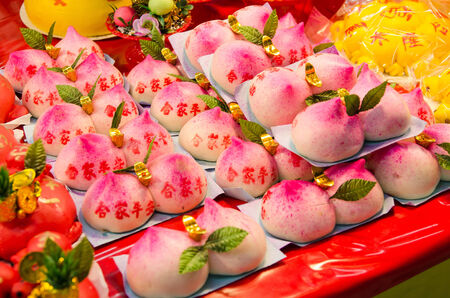 workship: Peach shaped steam bun selling in the religious prayer ornaments stall during Nine Emperor Gods Festival