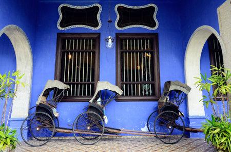 trishaw: Penang,Malaysia - December 29, 2011: Exterior view of Cheong Fatt Tze Mansion,Penang Editorial