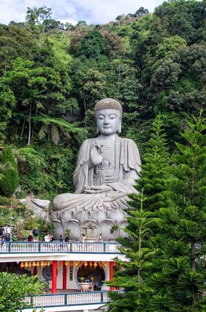 pahang: Pahang,Malaysia - January 25,2015:Stone buddha which is located at Chin Swee Caves Temple,Genting Highlands.People can see having photo shooting during weekend. Editorial