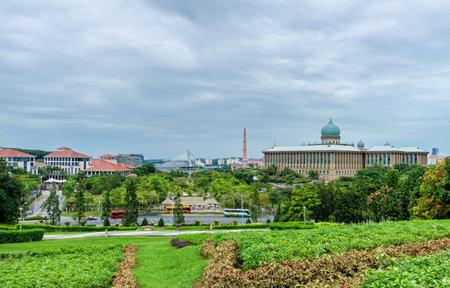 central government: Putrajaya,Malaysia - October 5,2014 : Malaysia Central Government building and Putrajaya Seri Wawasan Bridge can seen from Putra Perdana Park.