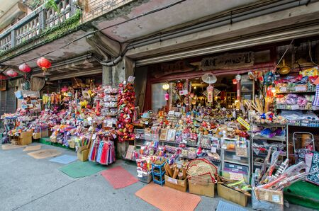 jiufen: Jiufen,Taiwan - March 18,2015 : The shops in Jiufen Old Street are vending the most famous country snack of Jiufen, and various local accessories.
