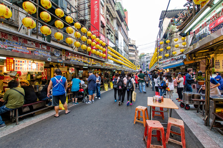 night market: Keelung,Taiwan - March 18,2015 : Keelung Miaokou night market famous throughout Taiwan for its large selection of food.People can seen walking and exploring around it. Editorial