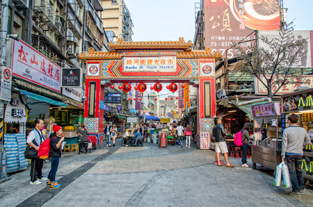night market: Taipei,Taiwan - March 14,2015 : Entrance of the Raohe Street Night Market,people can seen walking and exploring around it. Editorial