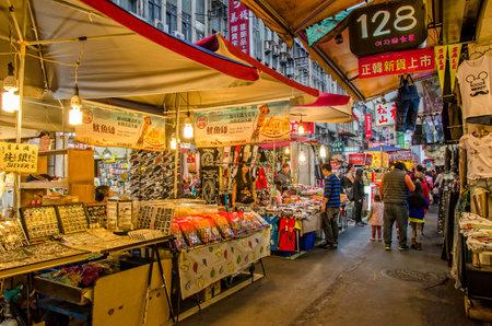 night market: Taipei,Taiwan - March 14,2015 :  Raohe Street Night Market,people can seen walking and exploring around it. Editorial
