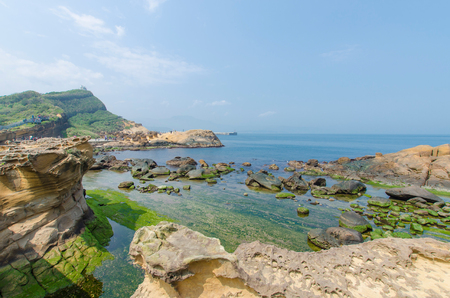 promontory: Nature landscape view of Yehliu Geopark. It  is a cape in the town of Wanli, New Taipei, Taiwan,the cape known by geologists as the Yehliu Promontory Stock Photo