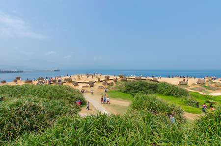 geologists: New Taipei,Taiwan - March 15, 2015: Nature landscape view of Yehliu Geopark. It  is a cape in the town of Wanli, New Taipei, Taiwan,the cape known by geologists as the Yehliu Promontory